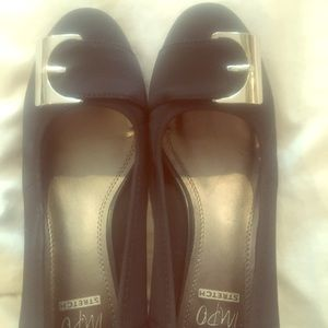 Black wedged heels with silver buckle accent